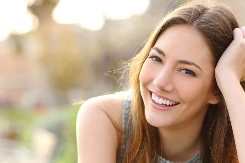 cosmetic dentist gilbert - brown haired girl smiling